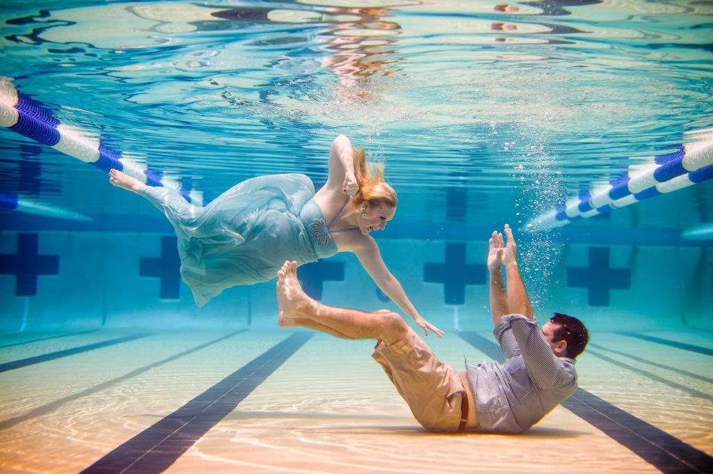 Super cool underwater engagement photos salon tease hair makeup escapades for Underwater luminaire for swimming pool