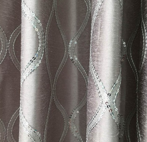 The grey curtain with the silvery thread and crystal detail.