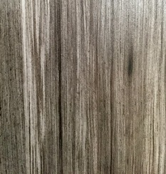 The sleek and shiny grey wood grain for all the salon cabinetry.
